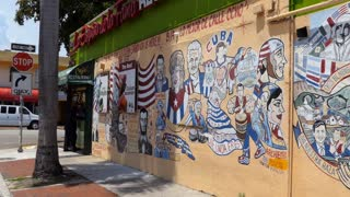 View of Calle Ocho in Little Havana district in Miami, Florida, USA with graffiti on wall of restaurant