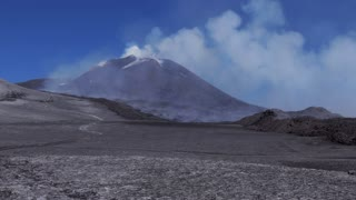View of crater summit, snow, lava, smoke, magma and molten rocks. March 2017 eruption on Mount Etna in Sicily, southern Italy, the largest active volcano in Europe. UNESCO World Heritage site