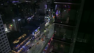 View of Gangnam-daero Boulevard in Gangnam district, Seoul, South Korea, Asia. Traffic, cars, buses during rush hour at night. Time-lapse