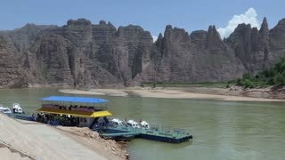 View of the Yellow River near Bingling, Gansu province, China, Asia. Tourist boats in port, mountains, natural landscape, water, nature and countryside