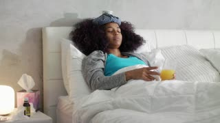 Weak Young Woman Lying In Bed For Flu And Cold