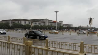 Wide angle view of Tiananmen Square in Beijing, China, Asia with cars, traffic and people