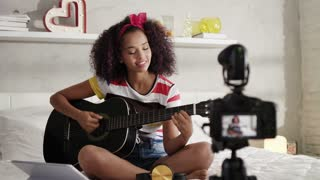 Woman Girving Guitar Class On Internet With Video Tutorial
