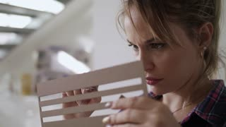 Woman Working As Architect Building Housing Model Mock-up