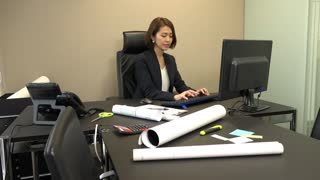 Young Asian people at work in architect office. Japanese business women working in engineer studio. Team of businesswoman and assistant looking at ipad digital tablet during meeting