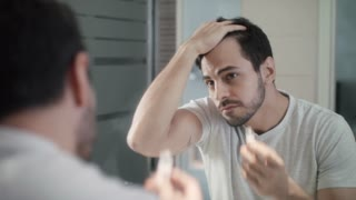 Young Man Applying Lotion For Alopecia And Hair Loss Treatment