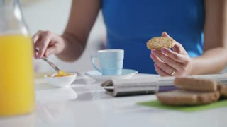 Young Woman Eating Breakfast At Home On Sunday
