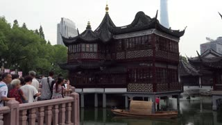Yuyuan Garden Tea House, famous tourist attraction and traditional old Chinese building in Shanghai, China, Asia located near Yu Garden. People and tourists during visit