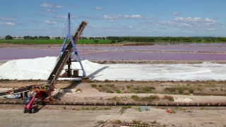 View of a salt factory near Aigues-Mortes in Camargue, southern France. French industry with heavy equipment and machinery for sea salt extraction from marine water