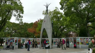 View of Children's Peace Monument in the Peace Memorial Park, Hiroshima, Japan, Asia. Memorial, landmark and statue with Japanese people, visitors, tourists during visit