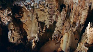 View of Dargilan cave in southern France, with geologic formations, stalactites, stalagmites, water erosion. French natural beauty and tourist destination