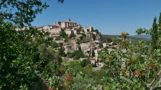 View of Gordes, famous village in the Luberon, Provence, southern France. Beautiful typical French town, monument and tourist attraction. Travel, holidays in Europe