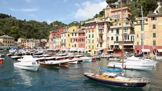 View of Portofino, beautiful and famous sea village in the Italian Riviera with boats in port