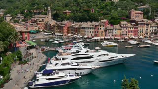 View of Portofino in Liguria, Italy. Beautiful and famous Mediterranean sea town in the Italian Riviera. Travel, tourist destination, landscape, buildings, summer holidays, vacation in Europe, harbor