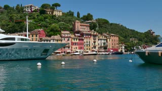 View of Portofino in Liguria, Italy. Beautiful and famous Mediterranean sea town in the Italian Riviera. Travel, tourist destination, landscape, buildings, summer holidays, vacation in Europe, port