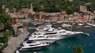 View of Portofino in Liguria, Italy. Beautiful and famous Mediterranean sea village in the Italian Riviera. Travel, tourist destination, landscape, building, summer holiday, vacation in Europe, harbor