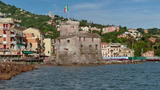 View of Rapallo in Liguria, Italy. Beautiful and famous Mediterranean sea town in the Italian Riviera. Travel, tourist destination, landscape, buildings, summer holidays, monument, castle