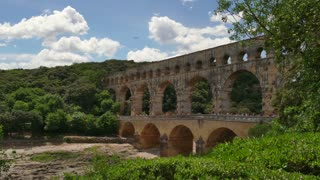 View of the famous Pont du Gard in Southern France. Ancient Roman aqueduct and bridge, tourist attraction and old French monument