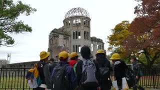 View of the Hiroshima Peace Memorial or the Atomic Bomb Dome in Hiroshima, Japan, Asia with Japanese people, visitors, tourists, school children during visit