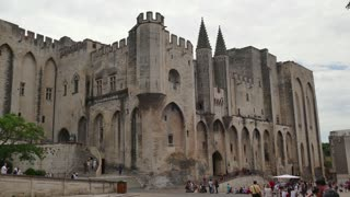 View of the Palace of the Popes in Avignon, famous town in Provence, southern France. Beautiful French city with monuments and tourist attractions. Travel, holidays in Europe