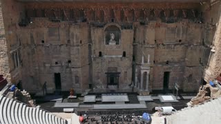 View of the Roman Theatre in Orange, famous town in southern France. Monument and tourist attraction in beautiful French city. Travel, holidays in Europe
