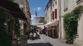 View of the traditional medieval village of Aigues-Mortes in Camargue, Southern France. Aigues Mortes, beautiful typical French town and tourist attraction. Travel, holidays in Europe