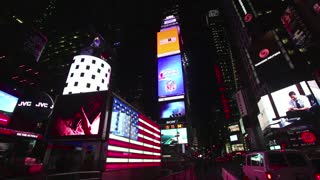 View of Times Square with people, crowd, traffic at night. New York City, Manhattan, NY, Unites States of America, USA. Sequence