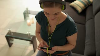 Woman Listening Music Podcast On Phone With Earphones