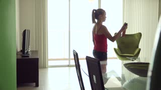 Woman Spraying Deodorant Spray Ambient Perfume At Home