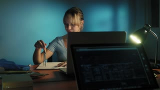Woman With Eyes Tired Working Late At Night In Office