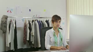 Woman Working As Businesswoman With Computer Phone In Fashion Studio