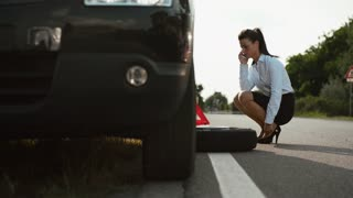 Women, emergency and driving problems, frustrated girl with flat car tire calling tow truck for roadside assistance