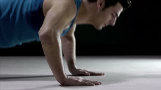 Young caucasian man, male athlete in sportswear doing push ups on black background in fitness gym. Sequence