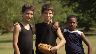 Young friends, boys, kids and recreation, three happy children with baseball smiling at camera