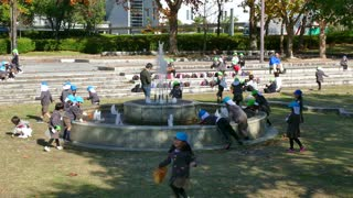 Young Japanese students, pupils, school children playing and having fun in Central Park (Chuo Koen) in Hiroshima, Japan, Asia. Leisure and recreational activities