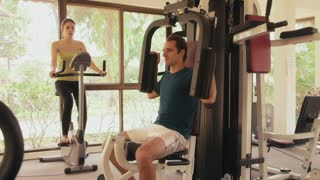 Young people and leisure, lifestyle and fun, leisure activities, man and woman on holiday. Sport athlete working as personal trainer and talking to customers in fitness club, gym