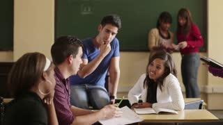 Young people at school, group of college students talking in university classroom