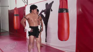Young people, athletes, sport activity, workout, gym, fitness, combat and extreme sports, asian men exercising in Yutakhun Khom, traditional martial arts of Cambodia, Asia. Teacher and student