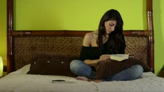 Young Woman Girl Reading Book On Bed At Home Lifestyle