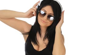 A young girl listens to music headphones and posing