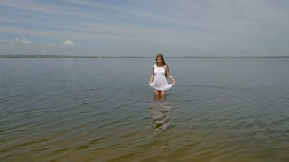 Girl in a white out of the water (slow motion)
