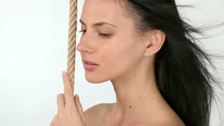 Girl posing with rope and flirting, slow motion
