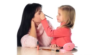 Little girl make-up mother
