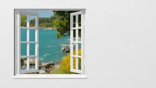 Looking out through the window at the sea in summer