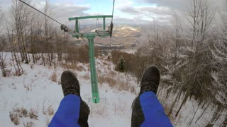Man goes to the ski lifts and dangled his legs