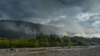 Morning fog in mountains and mountain river (Timelapse