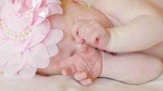 Newborn girl sleeping sweetly