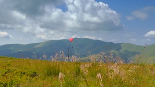 Paraglider flying high in the mountains