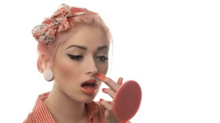 Portrait of pin-up girl does makeup