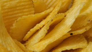 Potato chips on a plate spinning